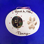 Pet pawprint and photo frame captured in clay